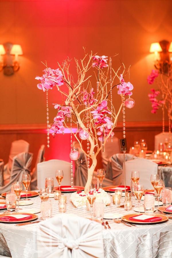 la-vie-en-rose-wedding-silver-chair-cover-linens-LED-up-lighting-guest-table-centerpiece-tree-hanging-crystal-strand-globes-phalaenopsis-orchid-drape-hyatt-regency-clearwater-beach-florida