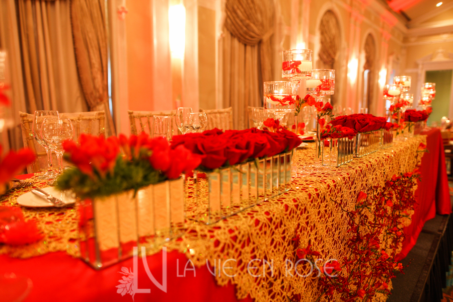 la-vie-en-rose-red-gold-chargers-stage-head-table-chiavari-chair-up-light-centerpiece-overlay-floating-candle-vinoy-renaissance-saint-petersburg-resort-and-golf-club-florida