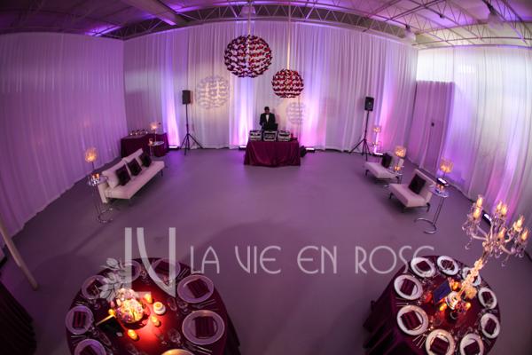 la-vie-en-rose-reception-white-lounge-furniture-crystal-lamp-butterfly-chandeliers-dance-floor-wedding-purple-venue-tampa-florida