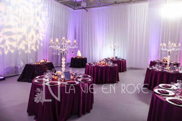 la-vie-en-rose-reception-cake-guest-table-pin-light-butterfly-crystal-candelabra-wedding-purple-venue-tampa-florida