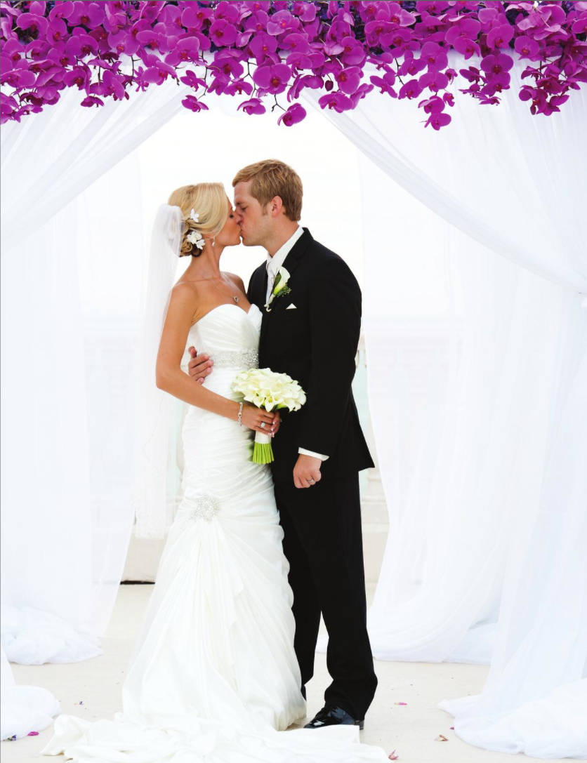 la-vie-en-rose-phalaenopsis-orchid-structure-drape-white-purple-bride-groom-kiss-ceremony-hyatt-clearwater-beach-florida