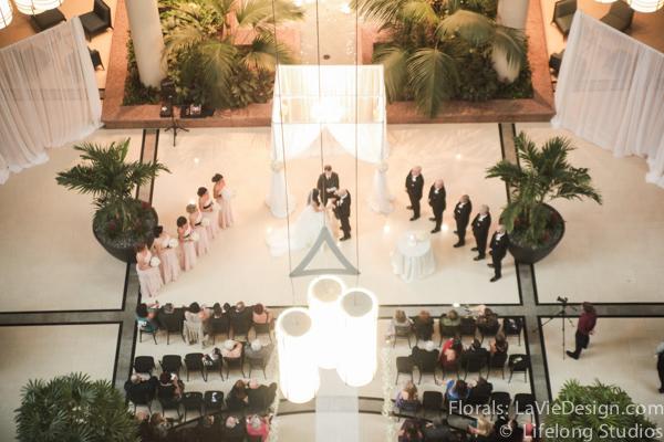 la-vie-en-rose-drape-chuppah-crystal-chandelier-atrium-blush-pink-white-ivory-intercontinental -tampa-florida