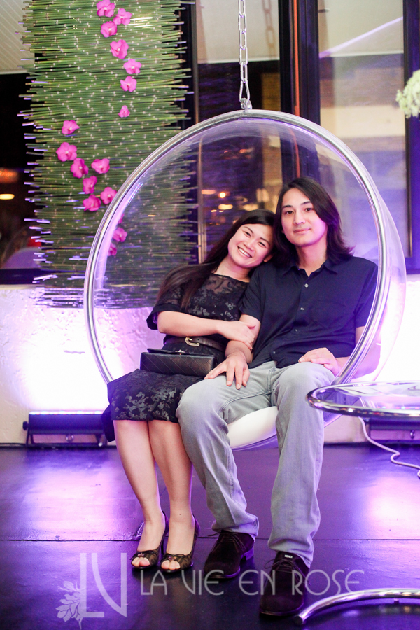 la-vie-en-rose-knot-wedding-mixer-bubble-chair-nic-nga-green-bamboo-backdrop-purple-orchid-1930-grand-room-tampa-florida