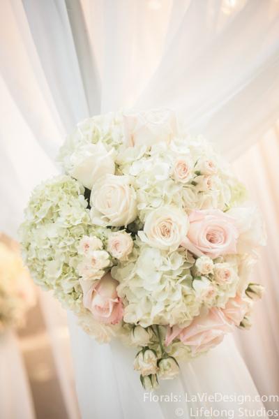 la-vie-en-rose-floral-arrangment-wedding-drape-ceremony-chuppah-crystal-chandelier-atrium-blush-pink-white-ivory-intercontinental-tampa-florida