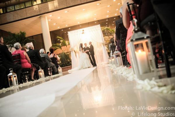la-vie-en-rose-pink-aisle-lanterns-candles-white-ivory-atrium-intercontinental -tampa-florida