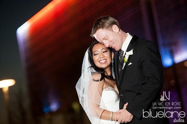 la-vie-en-rose-wedding-reception-bride-and-groom-dance-night-downtown-tampa-museum-of-fine-arts-lights-florida
