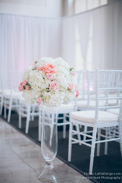 la-vie-en-rose-wedding-ceremony-flowers-pink-peony-white-hydrangea-tall-vase-the-vault-downtown-tampa-florida