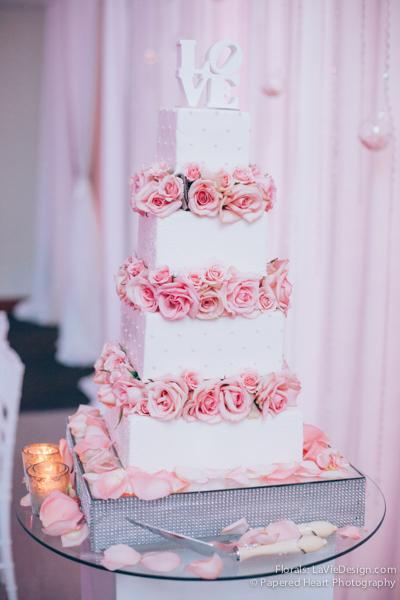 la-vie-en-rose-wedding-reception-three-tier-cake-pink-mercury-votive-drape-the-vault-downtown-tampa-florida