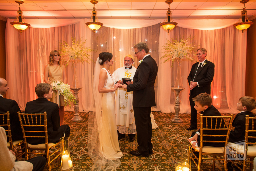 la-vie-en-rose-wedding-ceremony-large-arrangements-bride-and-groom-candles-uplighting-drapery-orchids-vows-the-tampa-club