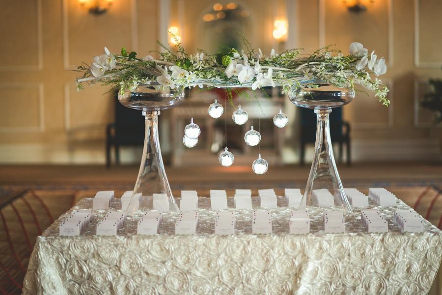 la-vie-en-rose-wedding-reception-place-card-table-floral-arrangement-guest-seating-hanging-globes-led-lights-elegant-romantic-love-specialty-linen-happily-ever-after-waldorf-astoria