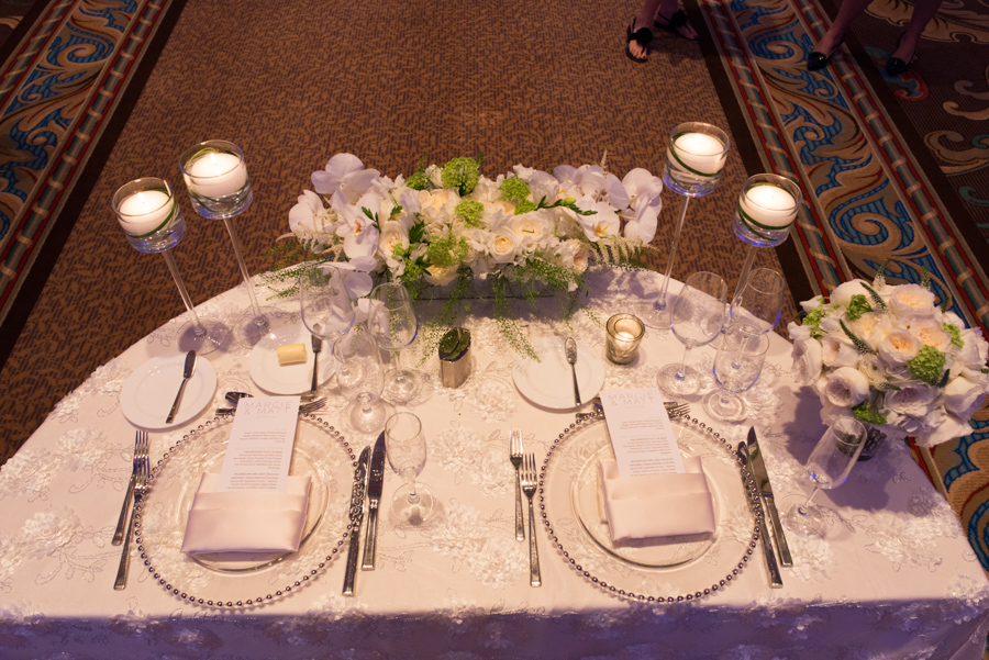 la-vie-en-rose-wedding-reception-table-linens-centerpiece-candles-sweetheart-table-mirrored-vase-half-crescent-moon-table-glass-beaded-chargers-floral-arrangements-hydrangeas-white-roses-hypericum-berries-green-fern-tulips-calla-lily-menu-napkins-floating-candle-stems-elegant-romantic-love-specialty-linen-happily-ever-after-waldorf-astoria