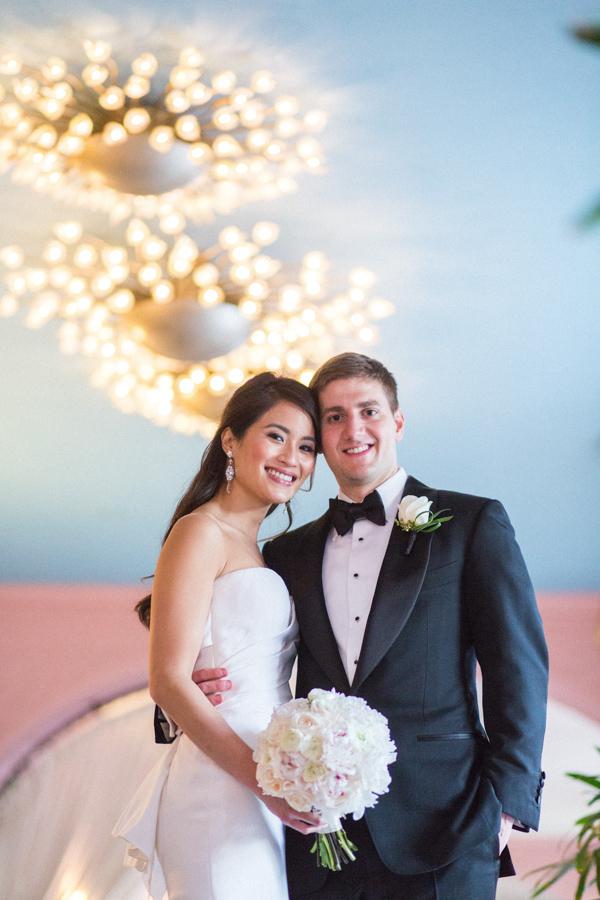 la-vie-en-rose-tampa-bay-saint-petersburg-wedding-hotel-bride-and-groom-lights-boutonniere-bouquet-peonies-garden-roses-romantic-elegant-the-vinoy