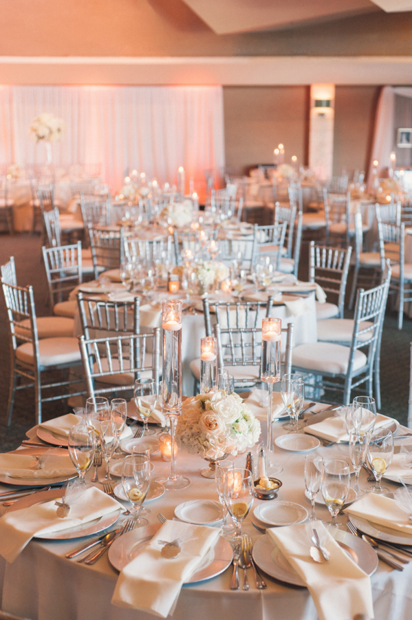 la-vie-en-rose-tampa-bay-Clearwater-wedding-reception-cake-table-decor-floral-arrangements-silver-chiavari-chairs-uplighting-floating-candles-votives-crystal-candelabra-white-drapery-table-specialty-linens-dupioni-wedding-party-roses-hydrangeas-white-ivory-linens-lace-specialty-overlay-napkins-romantic-elegant-Ruth-Eckerd-Hall