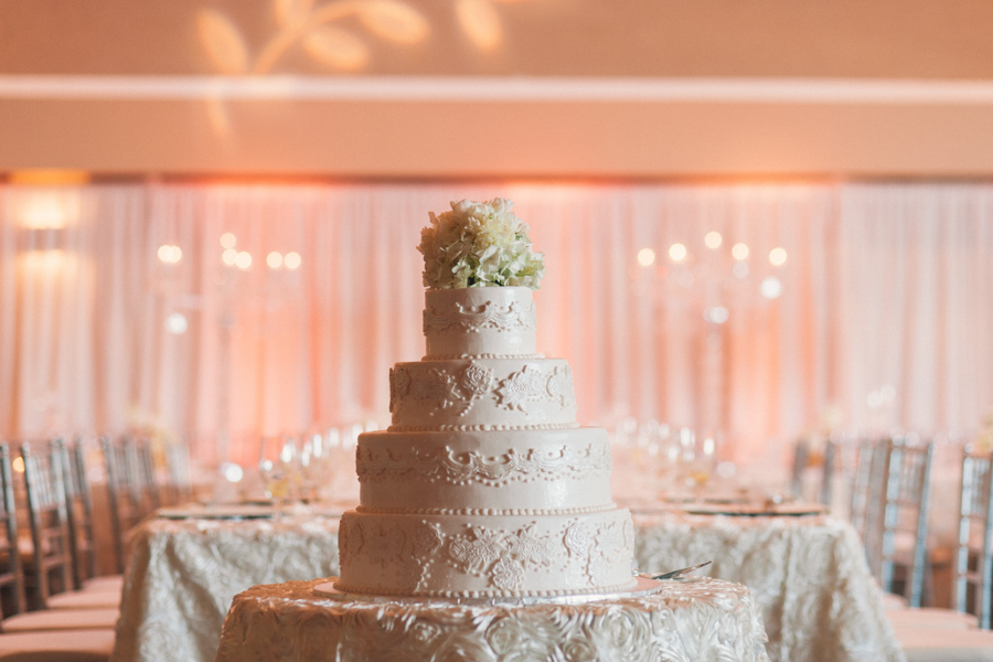 la-vie-en-rose-tampa-bay-Clearwater-wedding-reception-cake-table-decor-floral-arrangements-crystal-candelabra-white-drapery-table-specialty-linens-dupioni-wedding-party-roses-hydrangeas-white-ivory-linens-lace-specialty-overlay-napkins-romantic-elegant-Ruth-Eckerd-Hall