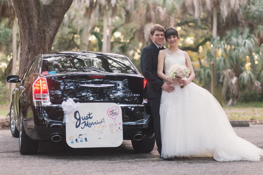 la-vie-en-rose-tampa-bay-Clearwater-wedding-bride-and-groom-wedding-dress-bridal-bouquet-roses-garden-rose-peonies-wedding-dress-boutonniere-outdoor-photo-shoot-romantic-elegant-just-married-Ruth-Eckerd-Hall