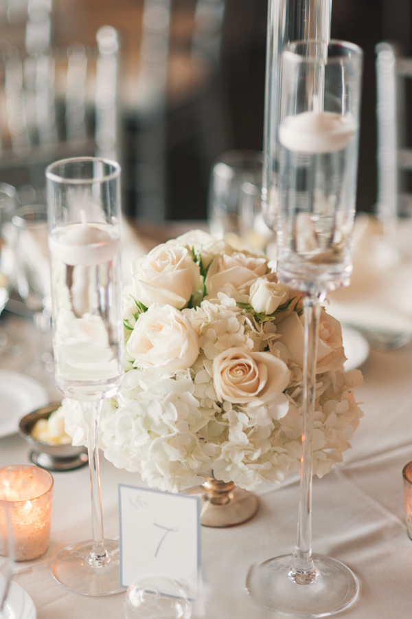 la-vie-en-rose-tampa-bay-Clearwater-wedding-reception-floating-candles-decor-floral-arrangements-table-specialty-linens-dupioni-centerpieces-tall-low-wedding-party-roses-hydrangeas-spray-roses-white-tones-blush-eucalyptus-silver-chiavari-chairs-silver-beaded-chargers-ivory-linens-napkins-romantic-elegant-Ruth-Eckerd-Hall