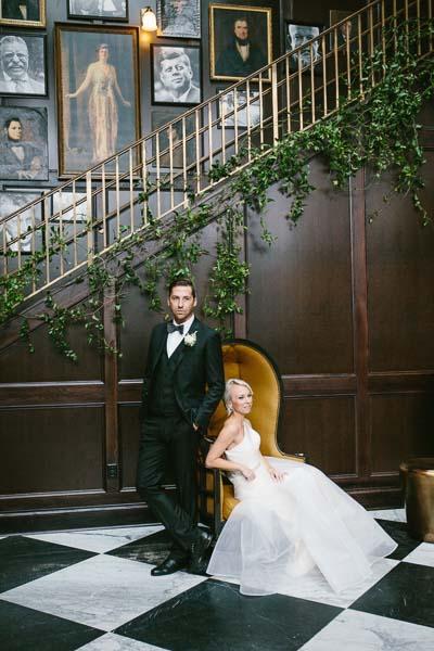la-vie-en-rose-tampa-bay-Florida-wedding-bride-groom-wedding-love-ceremony-staircase-reception-backdrop-flowers-boutonniere-greenery-garland-white-blooms-trendy-fashion-elegant-The-Oxford-Exchange