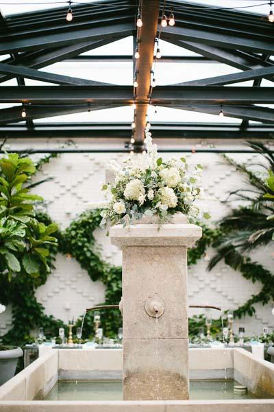la-vie-en-rose-tampa-bay-Florida-wedding-bride-groom-wedding-love-ceremony-reception-backdrop-flowers-greenery-garland-large-arrangement-white-blooms-trendy-fashion-elegant-The-Oxford-Exchange