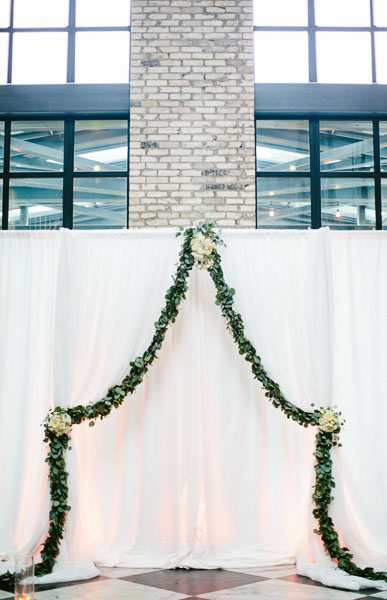 la-vie-en-rose-tampa-bay-Florida-wedding-bride-groom-wedding-love-ceremony-reception-backdrop-drapes-drapery-sheer-flowers-bridal-bouquet-boutonniere-greenery-garland-white-blooms-trendy-fashion-blush-ivory-elegant-The-Oxford-Exchange