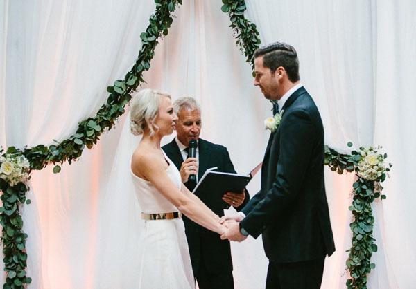 la-vie-en-rose-tampa-bay-Florida-wedding-bride-groom-wedding-love-ceremony-reception-backdrop-drapes-drapery-sheer-flowers-boutonniere-greenery-garland-white-blooms-trendy-fashion-blush-ivory-elegant-The-Oxford-Exchange