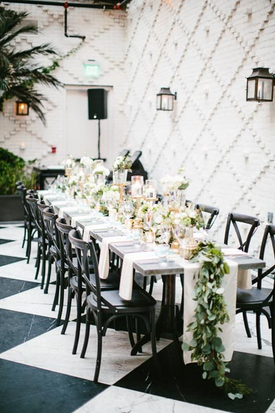 la-vie-en-rose-tampa-bay-Florida-wedding-love-ceremony-reception-votives-table-runner-napkins-flowers-small-eclectic-arrangement-greenery-garland-gold-candle-holders-white-blooms-blush-roses-stock-hydrangea-eucalyptus-astillbe-ivory-elegant-The-Oxford-Exchange
