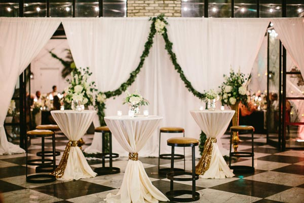 la-vie-en-rose-tampa-bay-Florida-sheer-wedding-drapery-drapes-backdrop-flowers-garland-greenery-linens-cocktail-hour-tables-sequin-tie-ivory-dupioni-candles-floral-arrangements-white-blooms-trendy-fashion-blush-ivory-elegant-The-Oxford-Exchange