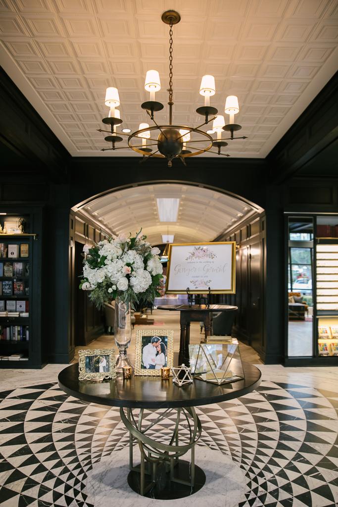 La-vie-en-rose-tampa-florida-wedding-gorgeous-entrance-centerpiece-white-ivory-blush-hydrangea-flower-garland-eucalyptus-elegant-oxford-exchange