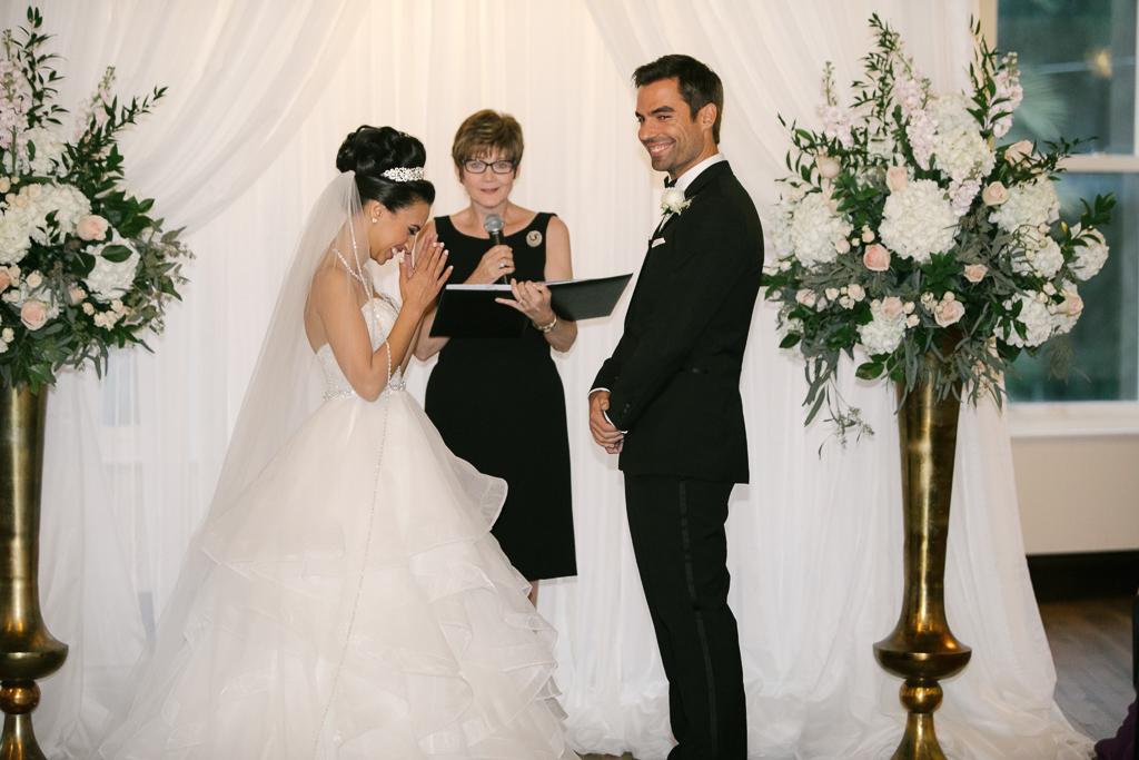 La-vie-en-rose-tampa-florida-wedding-gorgeous-ceremony-arch-drape-white-ivory-blush-hydrangea-flower-eucalyptus-elegant-oxford-exchange