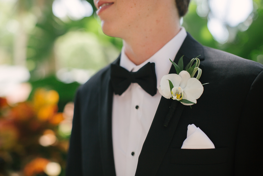 La-vie-en-rose-st-pete-florida-wedding-boutonniere-ceremony-white-ivory-orchid-elegant-vinoy