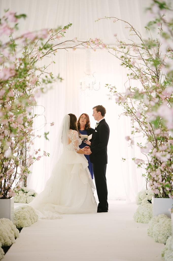 La-vie-en-rose-st-pete-florida-wedding-ceremony-arch-white-ivory-blush-hydrangea-cherry-blossom-flower-carpet-elegant-vinoy