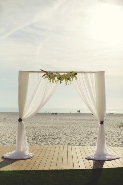 La-vie-en-rose-clearwater-beach-florida-wedding-gorgeous-ceremony-arch-drape-white-ivory-blush-flower-succulent—driftwood-elegant-sandpearl