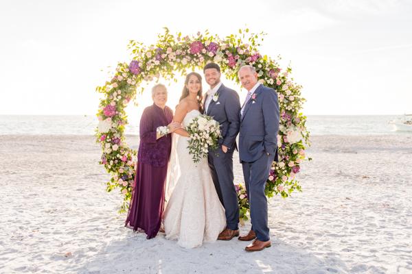 La-vie-en-rose-sarasota-florida-wedding-white-purple-ceremony-flower-arch-elegant-ritz-carlton-club