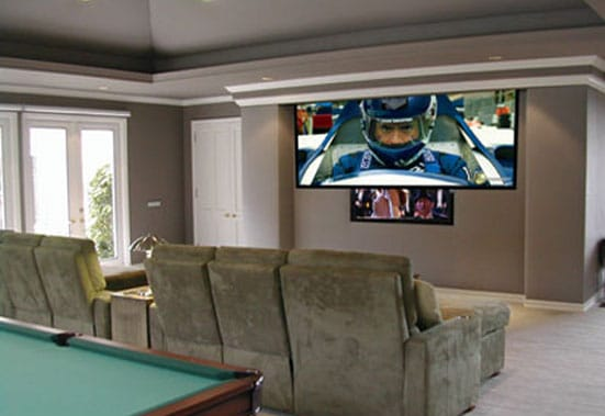 A multi-purpose game room transforms into a THX rated and Digital. Projection THome theater