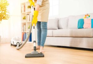 house cleaner vacuuming