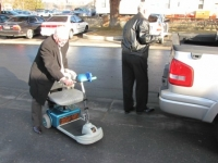 Bill Sawyer Gary Randel off loading scooter.jpg