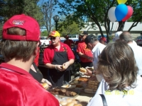 May 15Th_ Sgt-at-Arms Art Modler in Red&Yellow cover demostrating the proper way of making a hotdog.JPG
