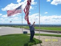 Jun11,2010_Cmdt Strawn hoisting up flag at Veterans Cemetery.JPG