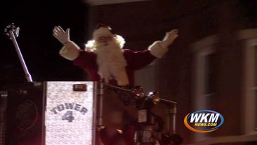 Santa Rides on a Fire Truck for a Christmas Parade!
