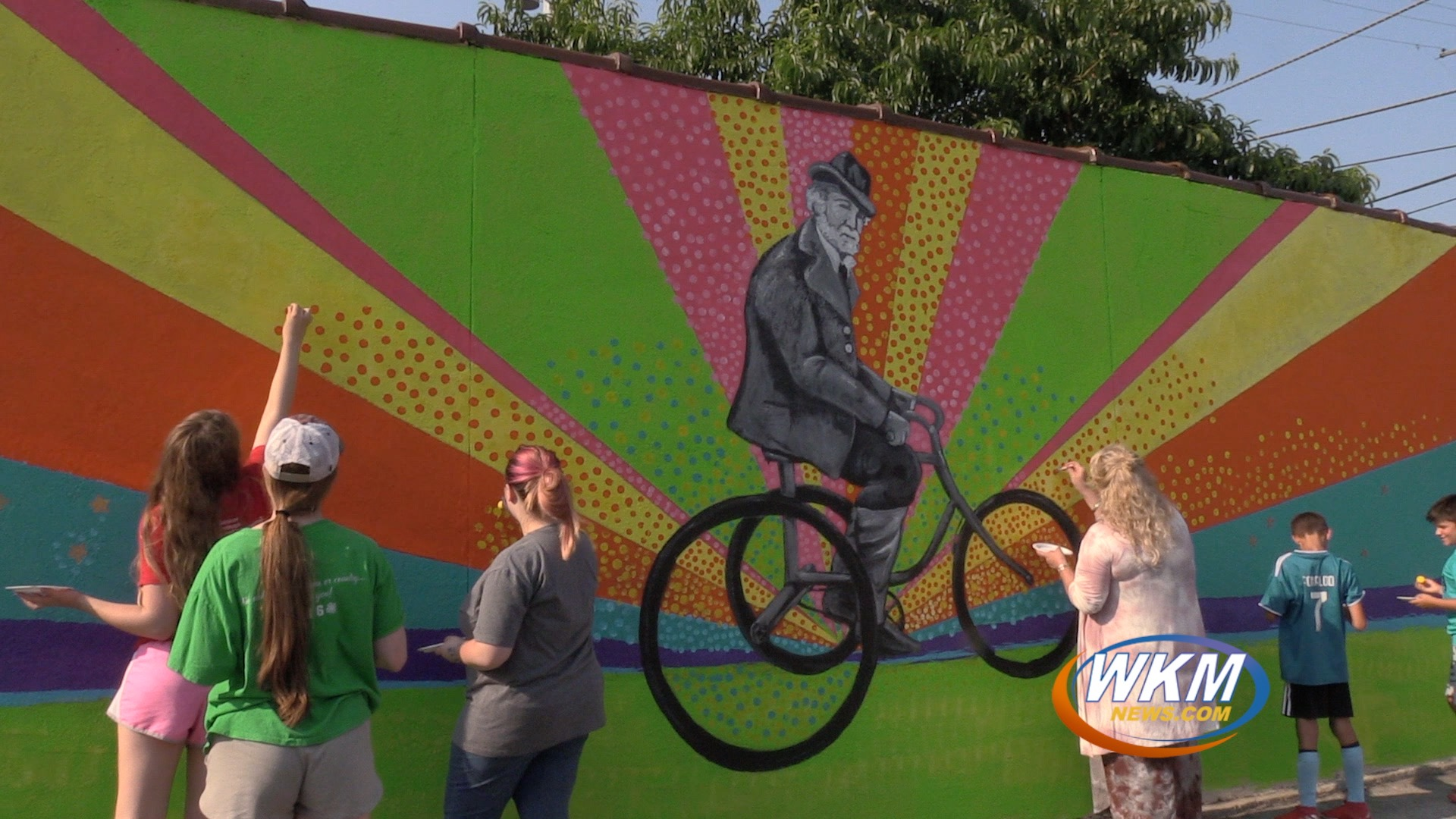 Creatives Join in With Painting Colorful Local Mural