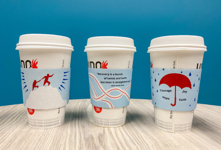 Photo of Recovery Month coffee sleeves on Kaladi Brothers coffee cups