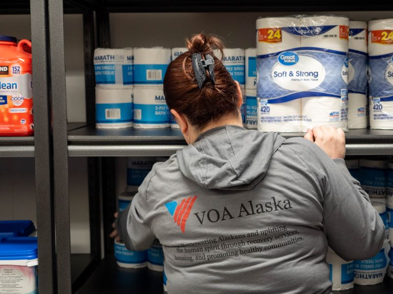 Staff member stocking shelves in the REACH pantry