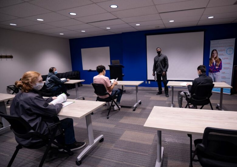 A staff member teaching a Prime for Life class