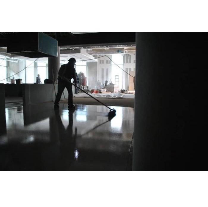 Contractor using CTS Rapid Set TRU self-leveling underlayment