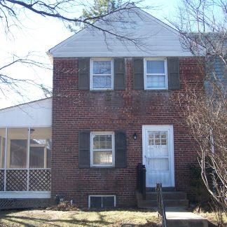 A two-story brick house in Monroe St. Arlington, Virginia