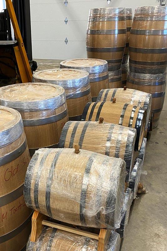 Whiskey barrels await aging