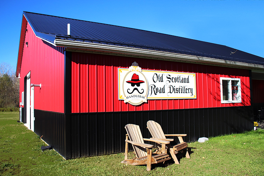 Exterior of Distillery on sunny day with blue skies