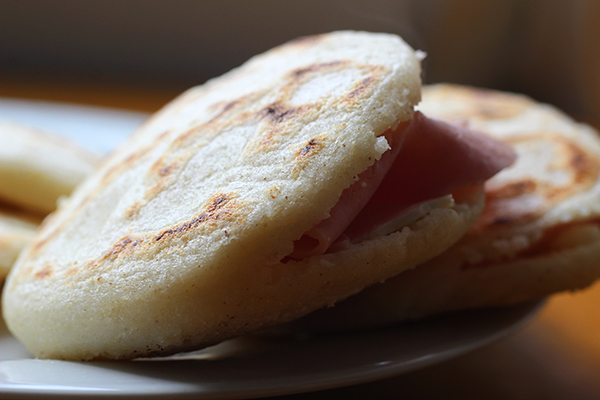 Arepas stuffed with ham on a white plate (3)