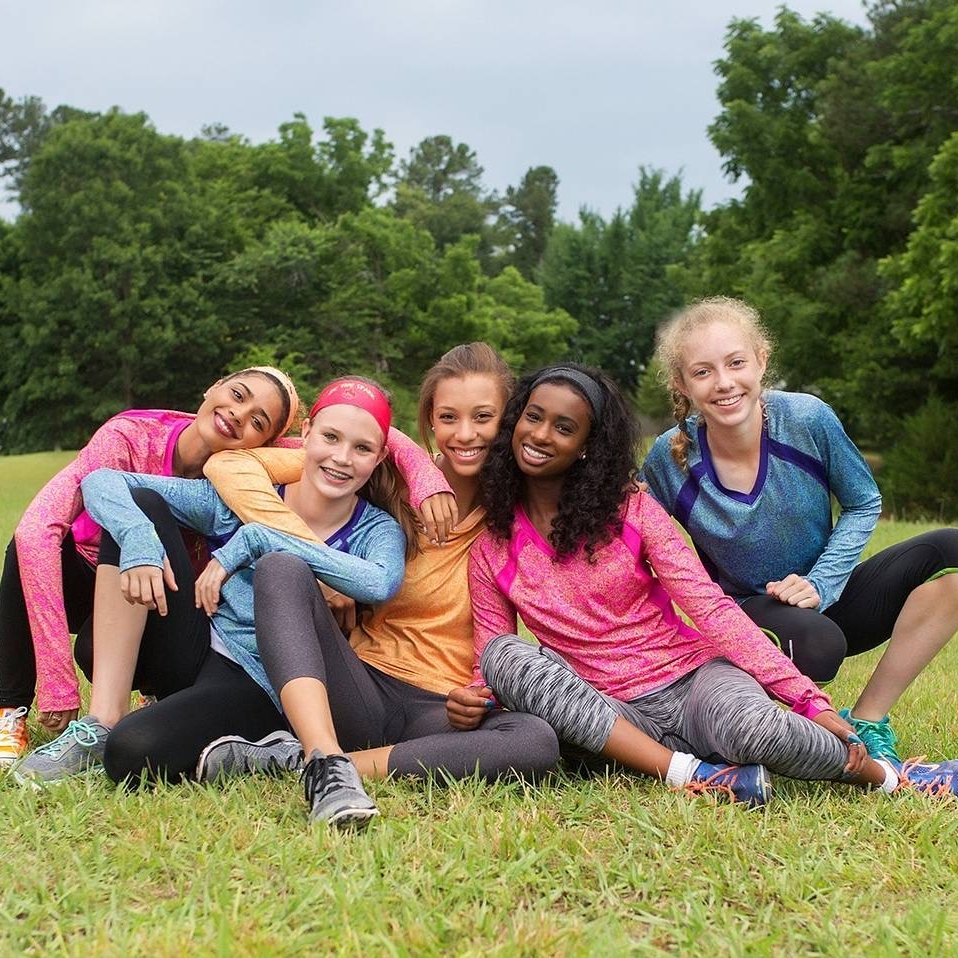 Sparkfire Image Nailed It Young Women with Athletic clothes hanging out outside field