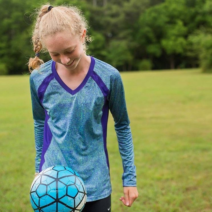 Sparkfire Image Nailed It Young Woman with Athletic clothes playing with soccer ball
