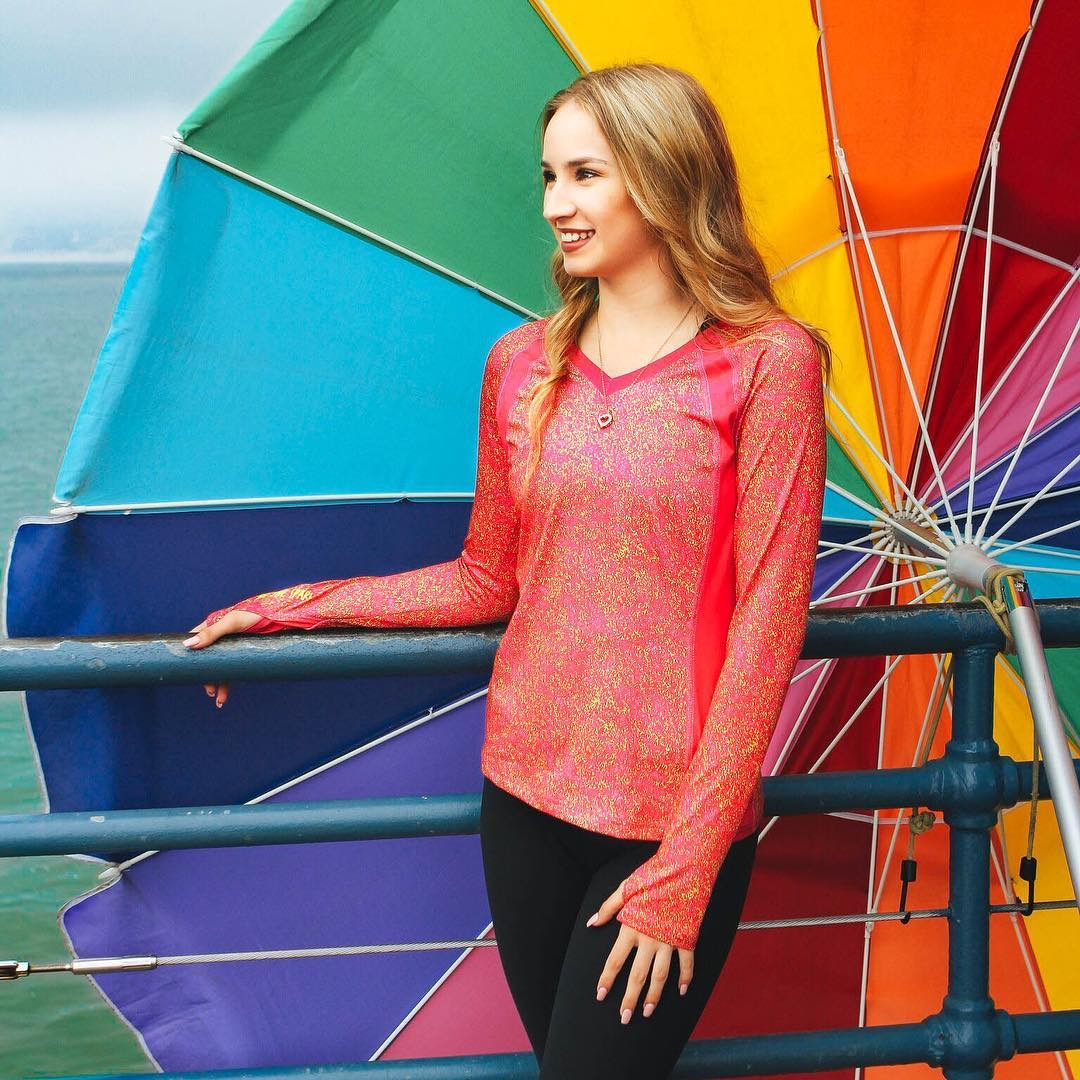 Sparkfire Image Nailed It Young Women with Athletic clothes in front of rainbow umbrella